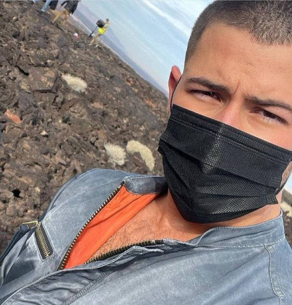 Nick Jonas with mask on