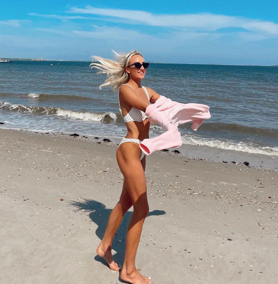 Nastia Liukin poses in white polka-dot bikini at the beach.