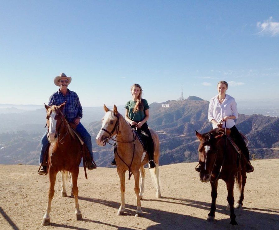 Amber Heard, father and sister on horseback