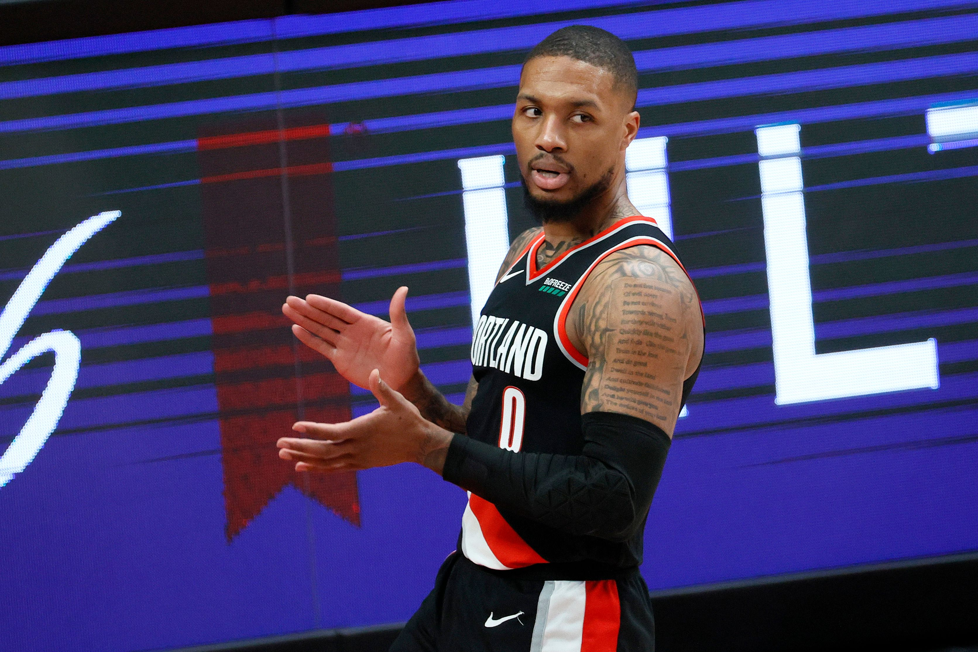 Damian Lillard claps after getting a favorable call