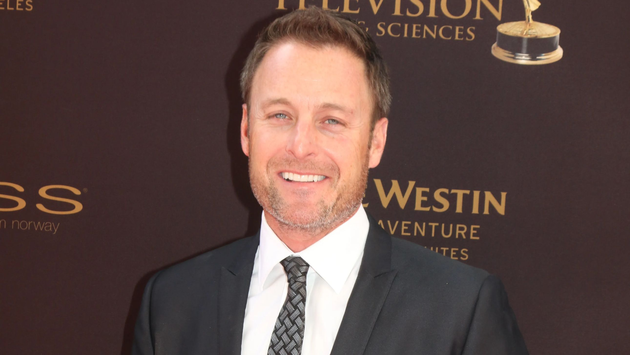Chris Harrison in a suit and tie