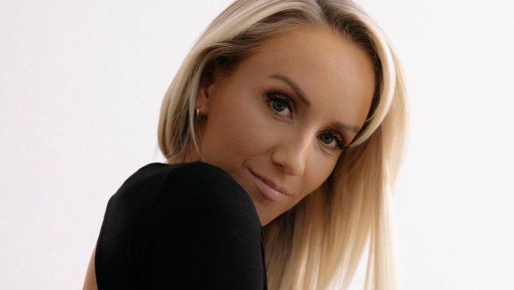 Nastia Liukin smiling in black