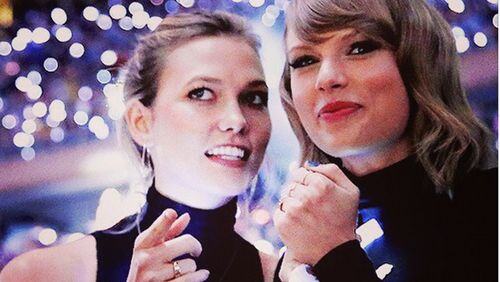 Karlie Kloss and Taylor Swift beam at a NY Knicks game in 2014