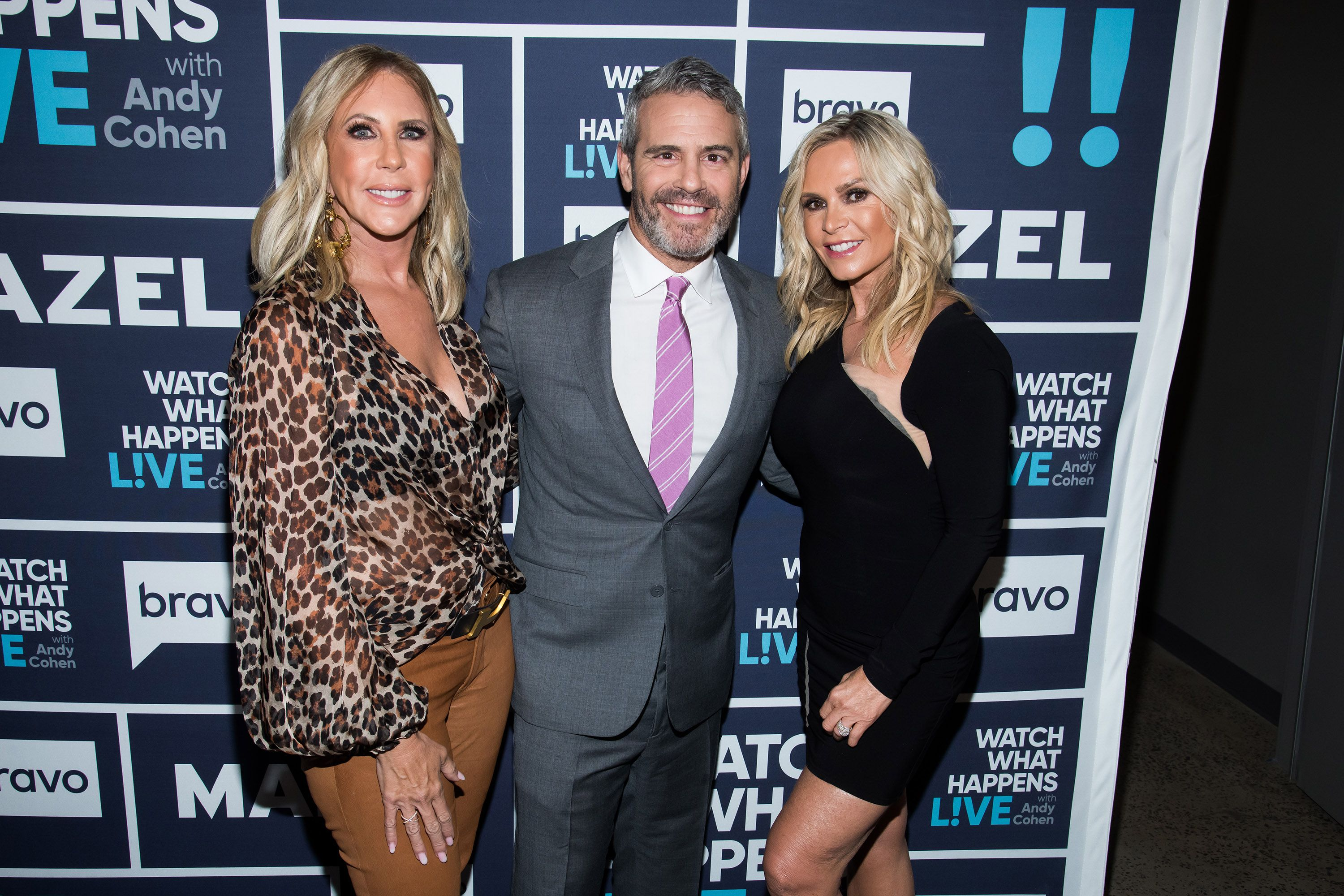 Vicki Gunvalson and Tamra Judge pose for a photo with Andy Cohen.