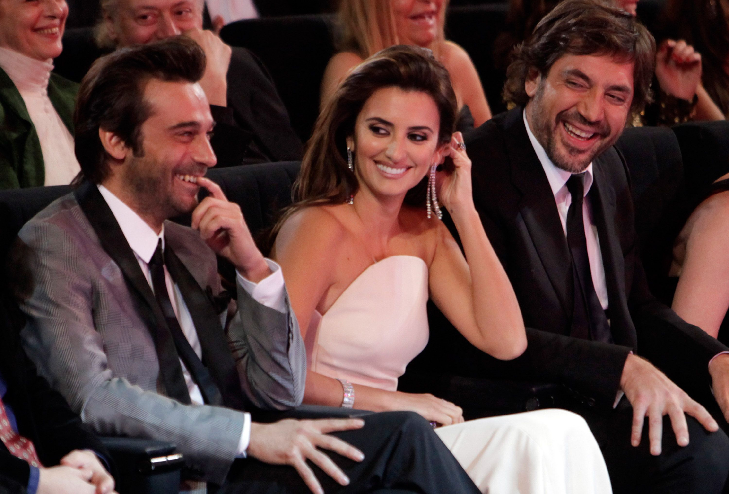 Penelope Cruz and husband seated at an event