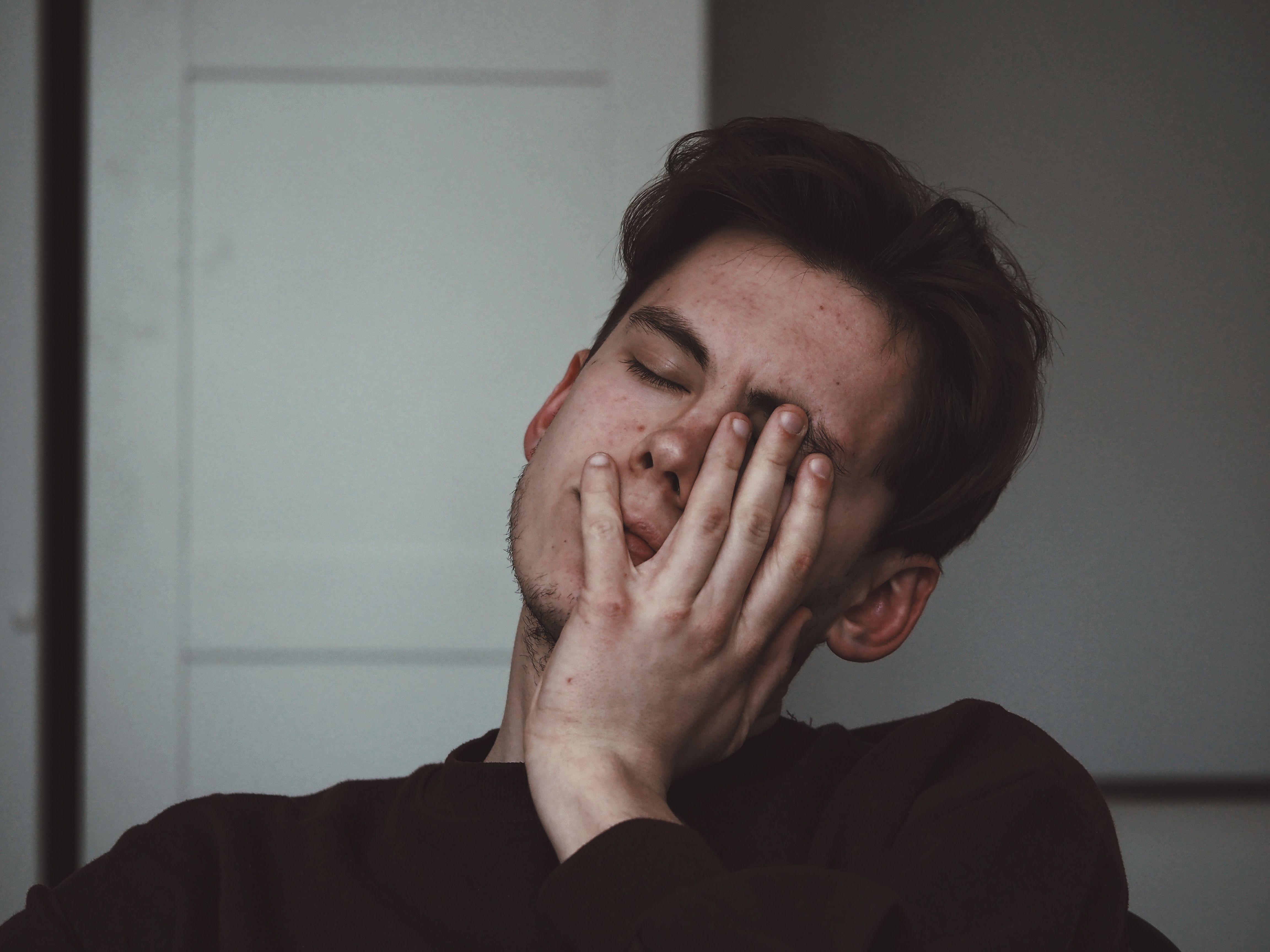 Young man expressing fatigue.