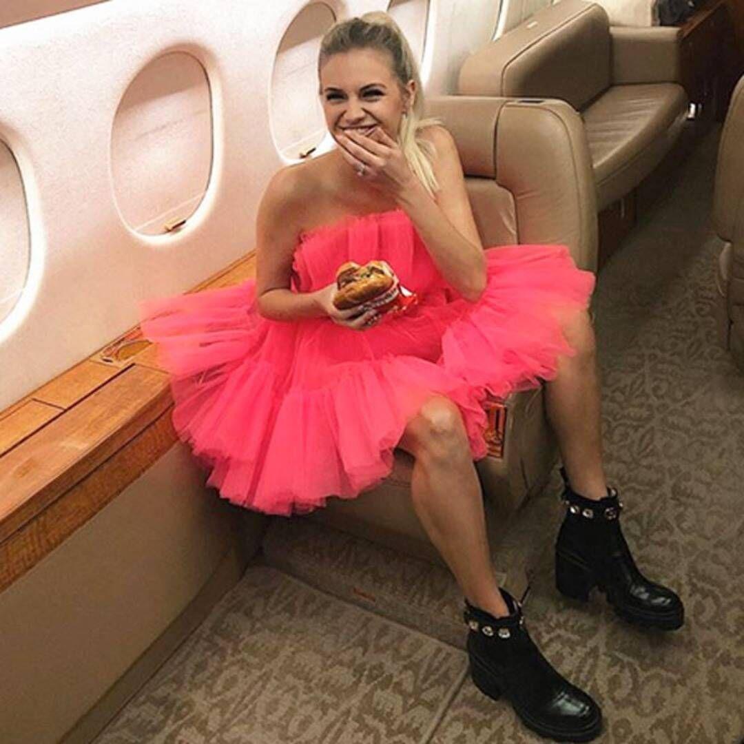Kelsea Ballerini on a plane in dress