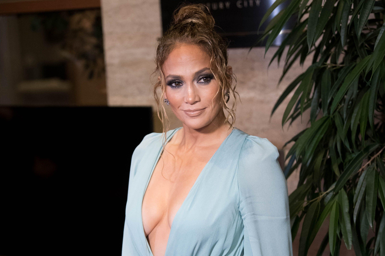 Jennifer Lopez wearing a revealing blue outfit.