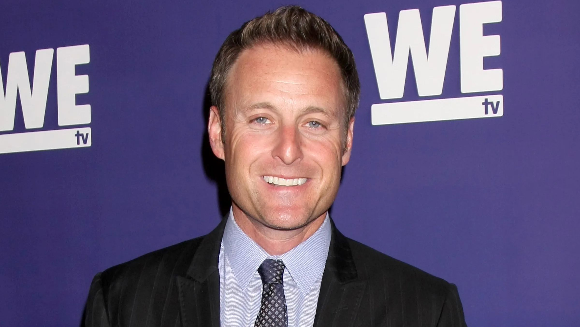 Chris Harrison smiling at a WEtv event