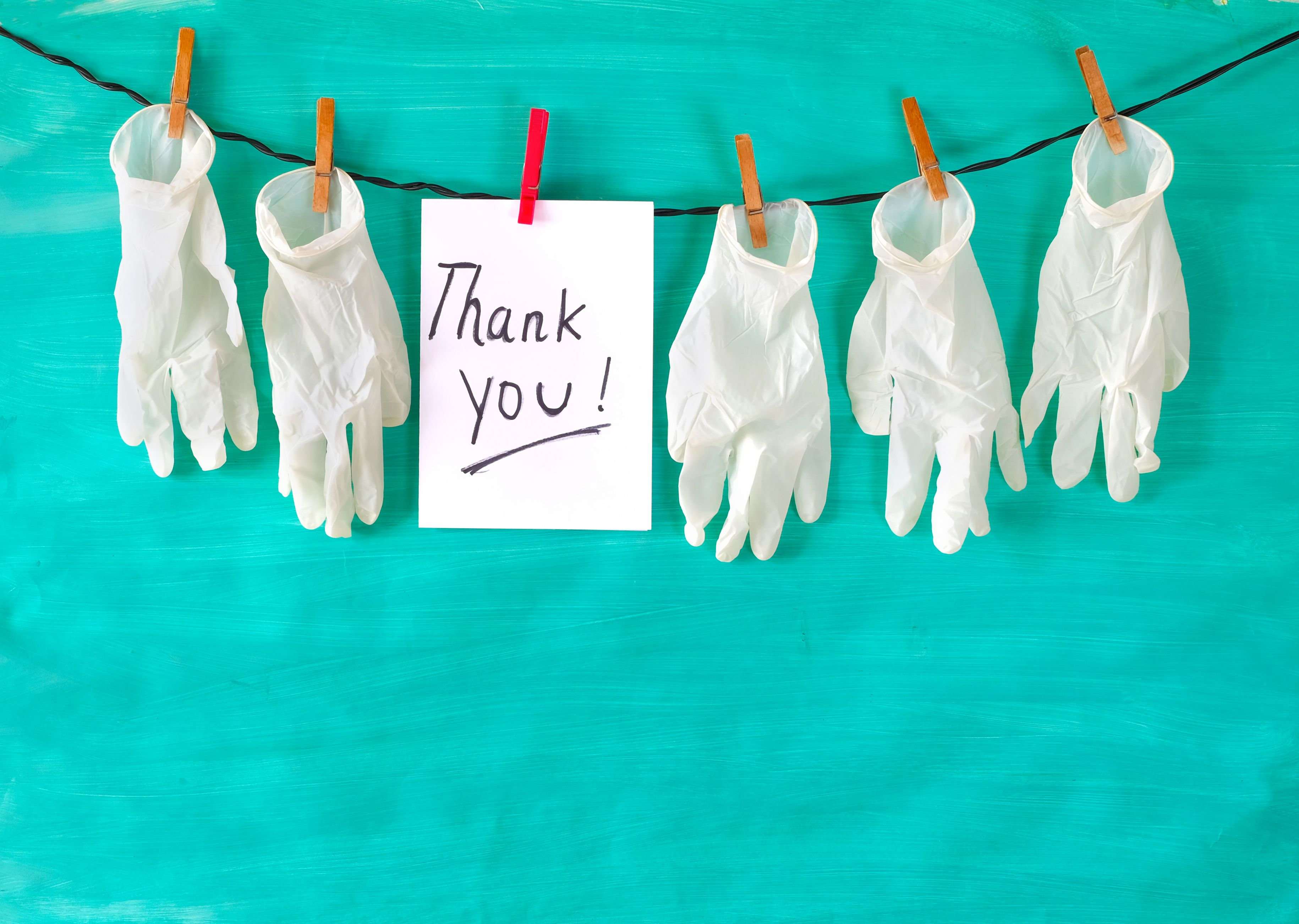 Nurses gloves and 'thank you' sign