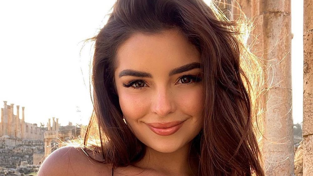 Demi Rose smiling and outdoors