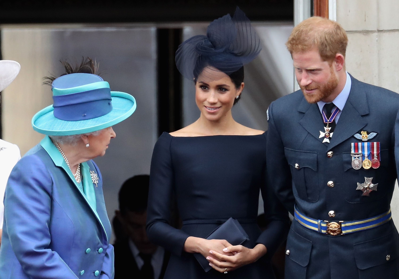 Queen Elizabeth II on Buckingham Palace balcony with Meghan Markle and Prince Harry