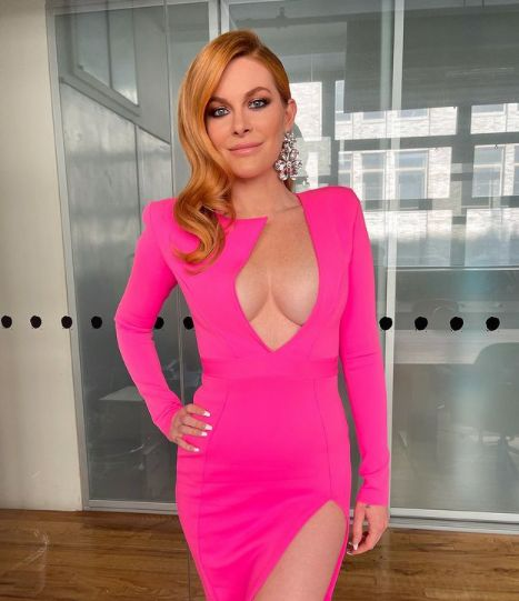 Leah McSweeney wears a hot pink dress.