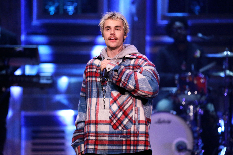Justin Bieber performing on stage.
