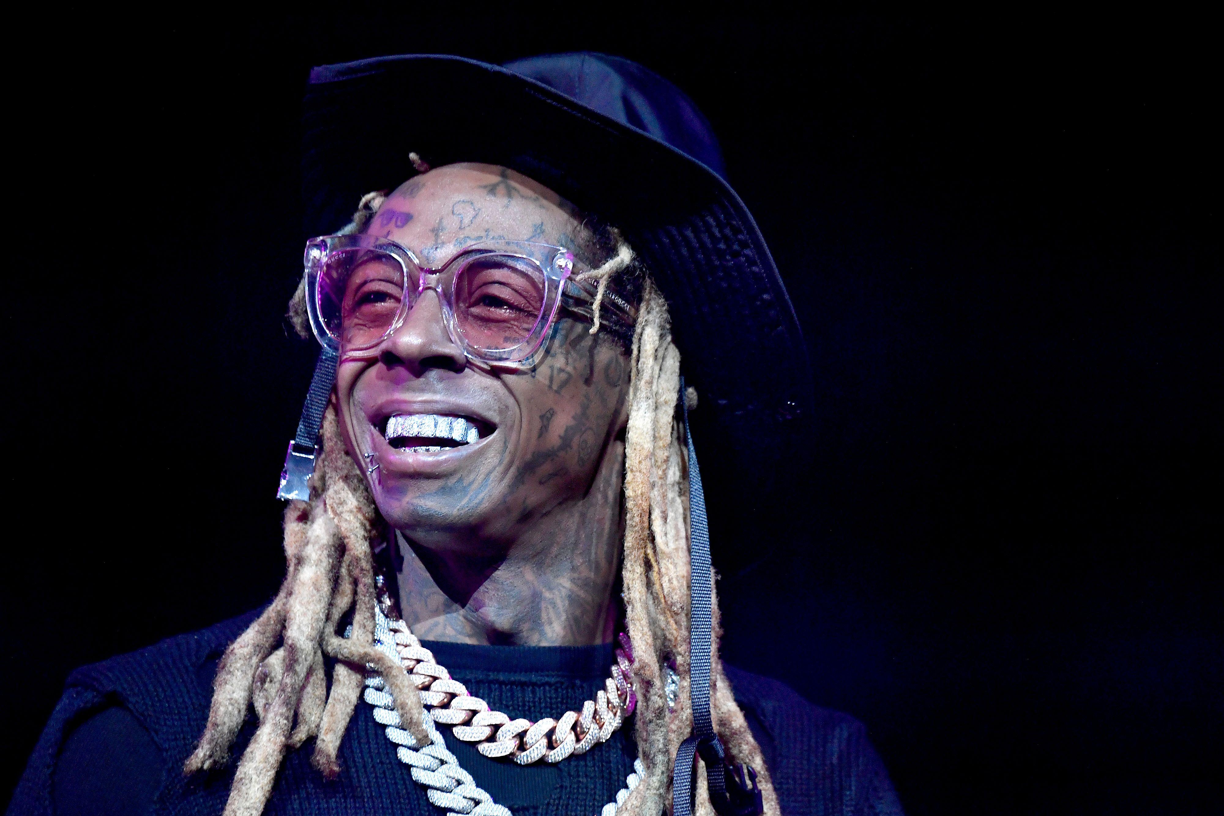 Lil Wayne smiling on stage.