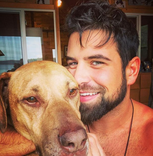 Blake Moynes takes a selfie with his dog