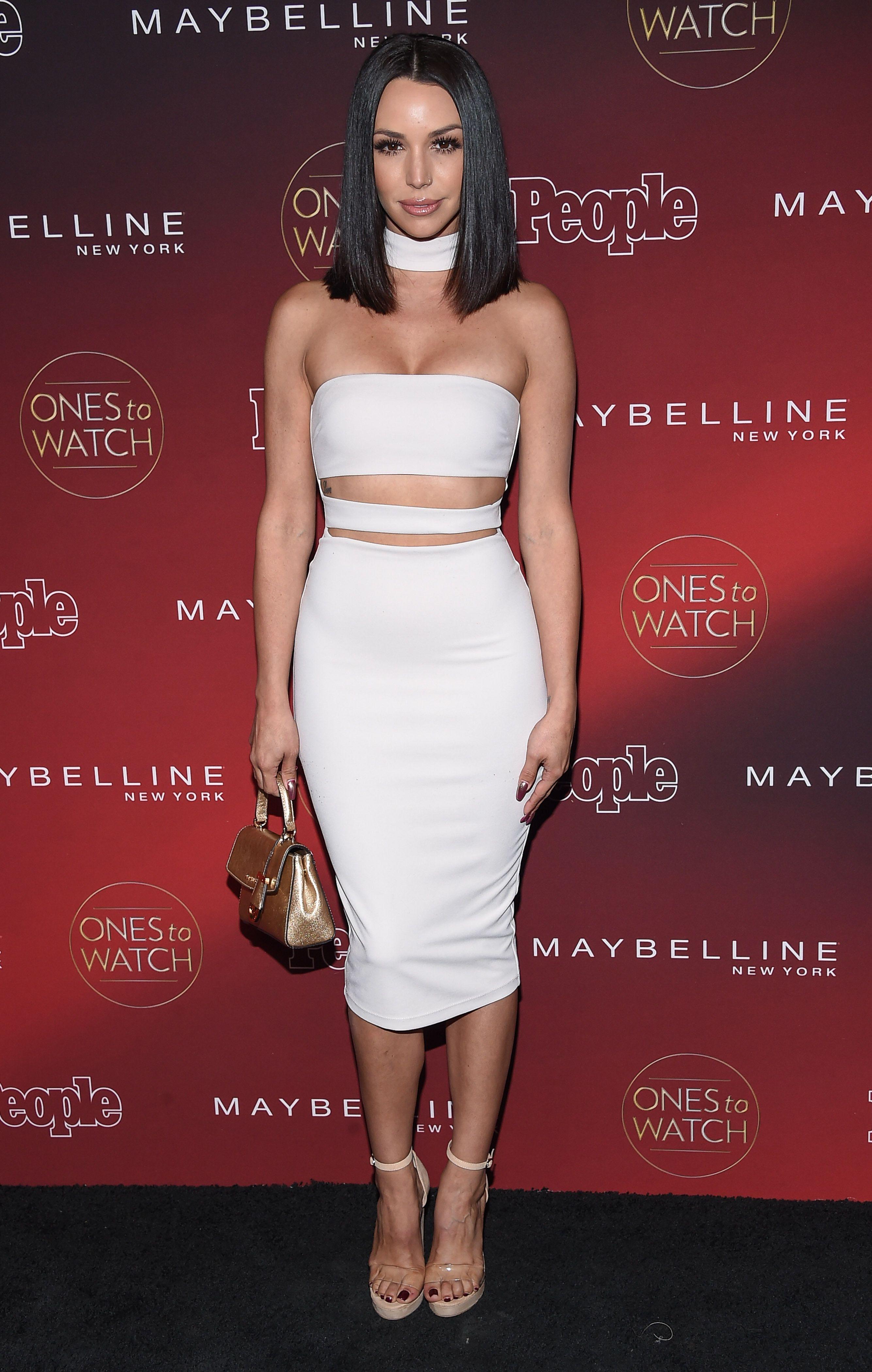Scheana Shay wears a white crop top set and choker.