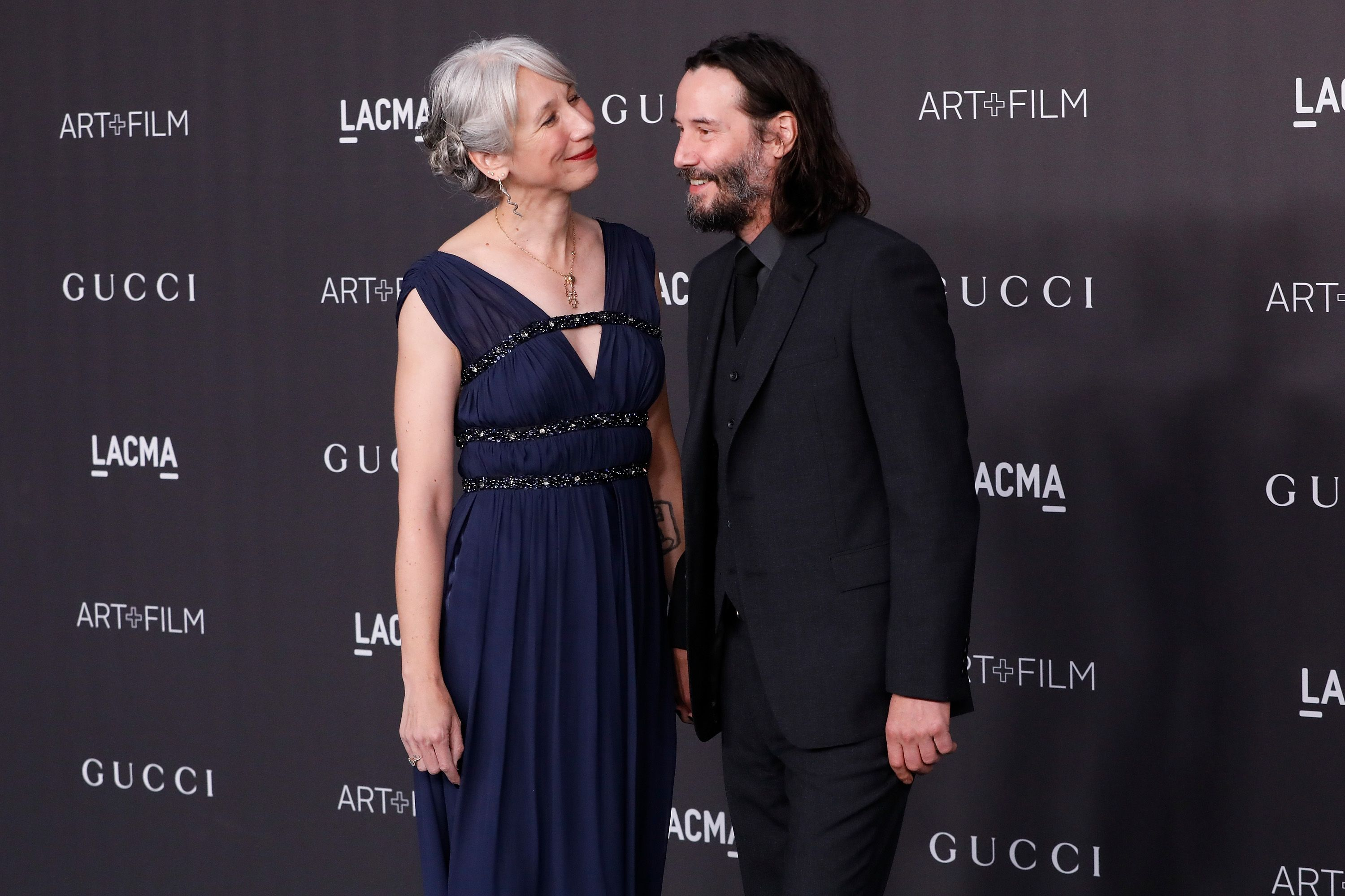 keanu reeves and alexandra grant at an event