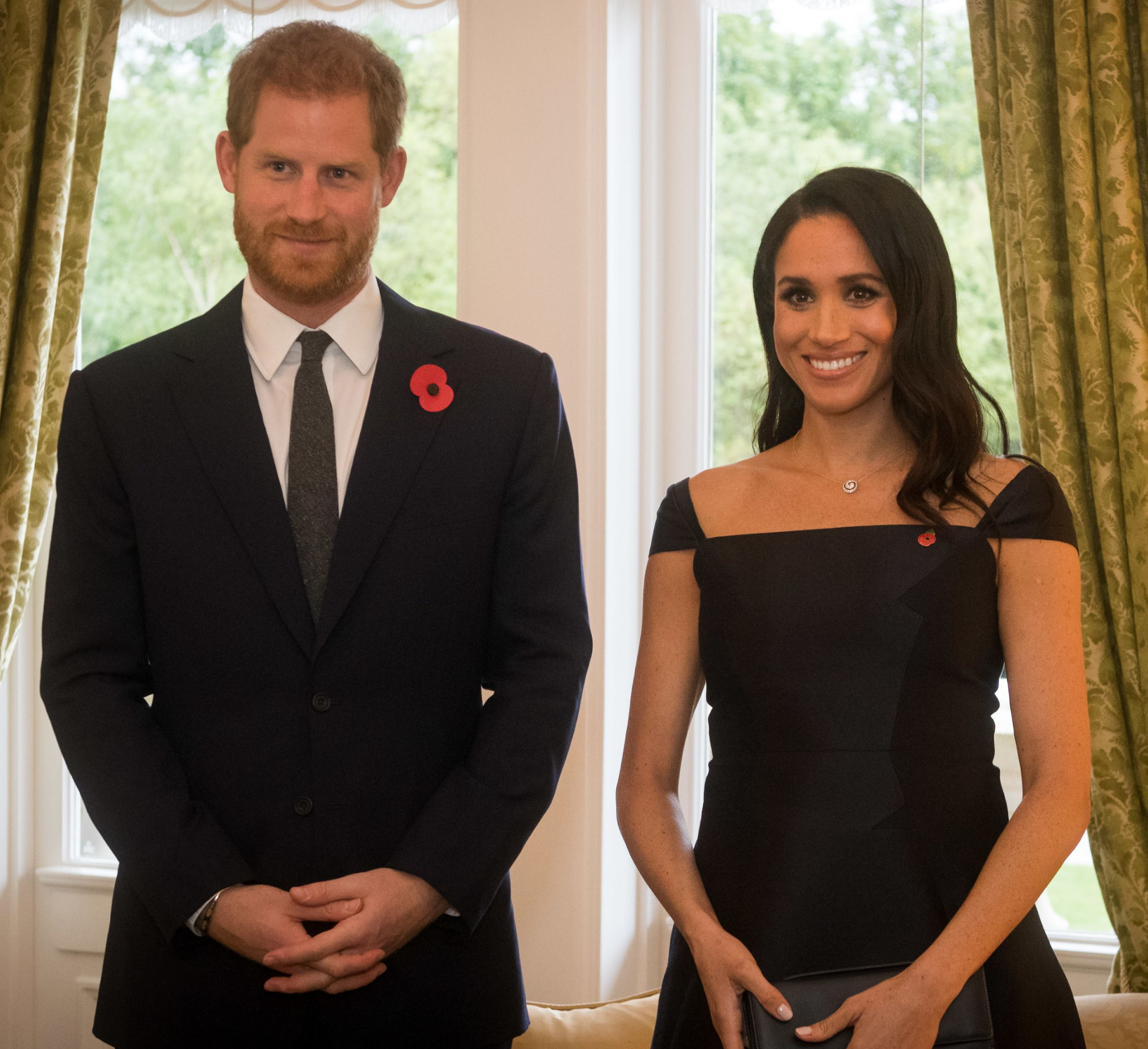 Prince Harry and Meghan Markle in black formal wear