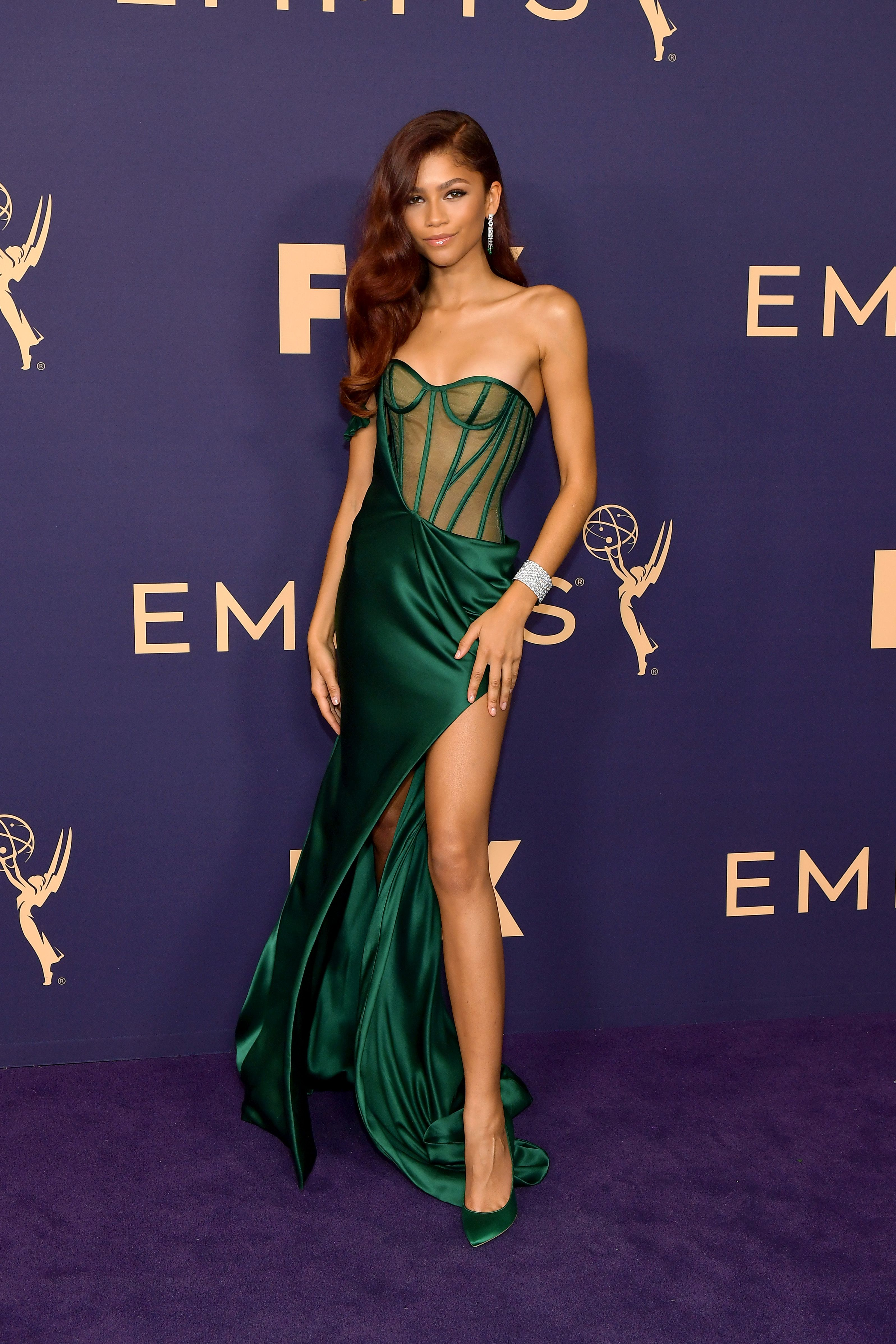 Zendaya wearing a green gown at a special event