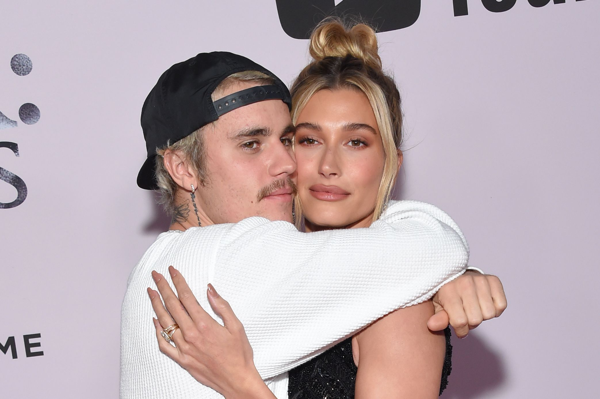 Justin Bieber and Hailey Baldwin holding each other