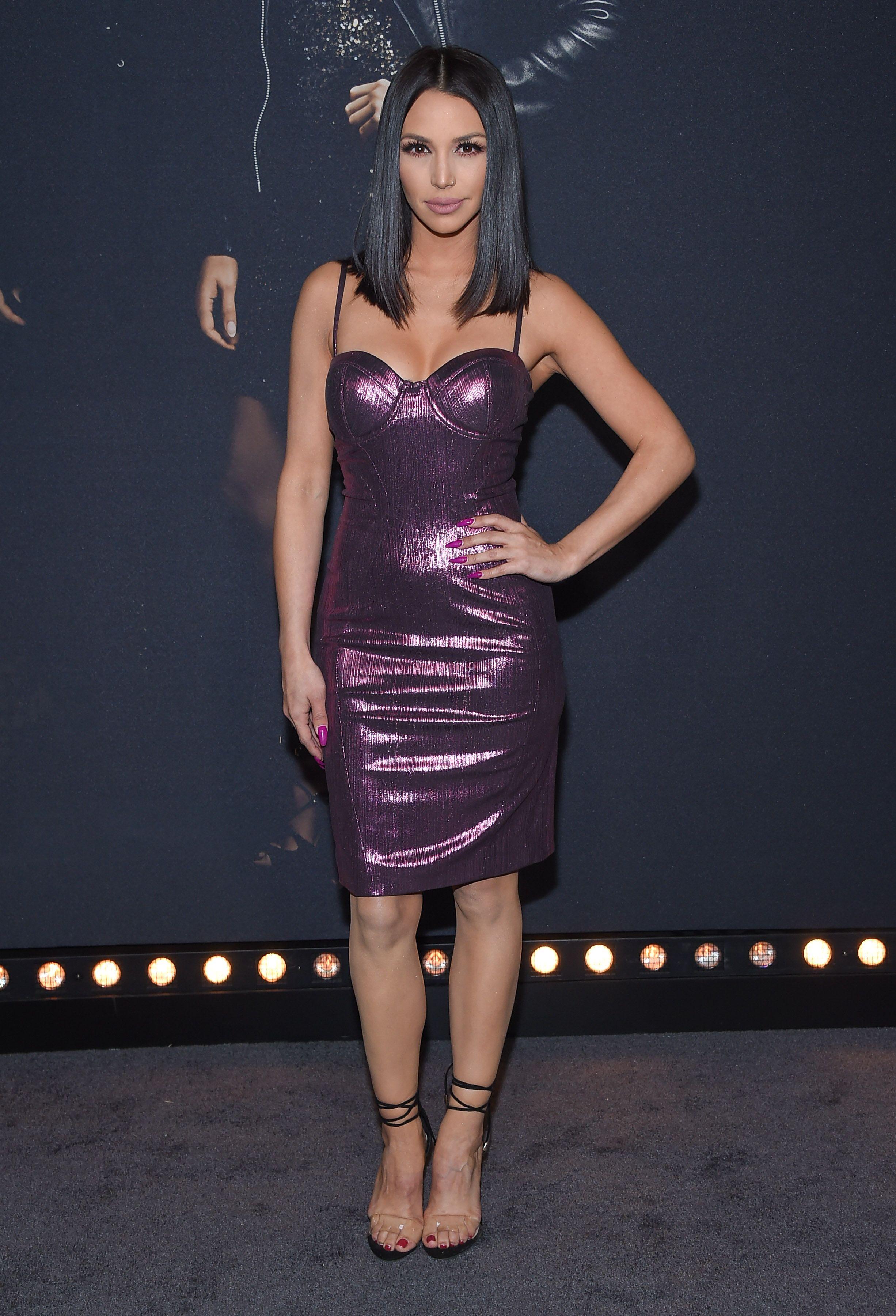 Scheana Shay wears a purple latex dress.