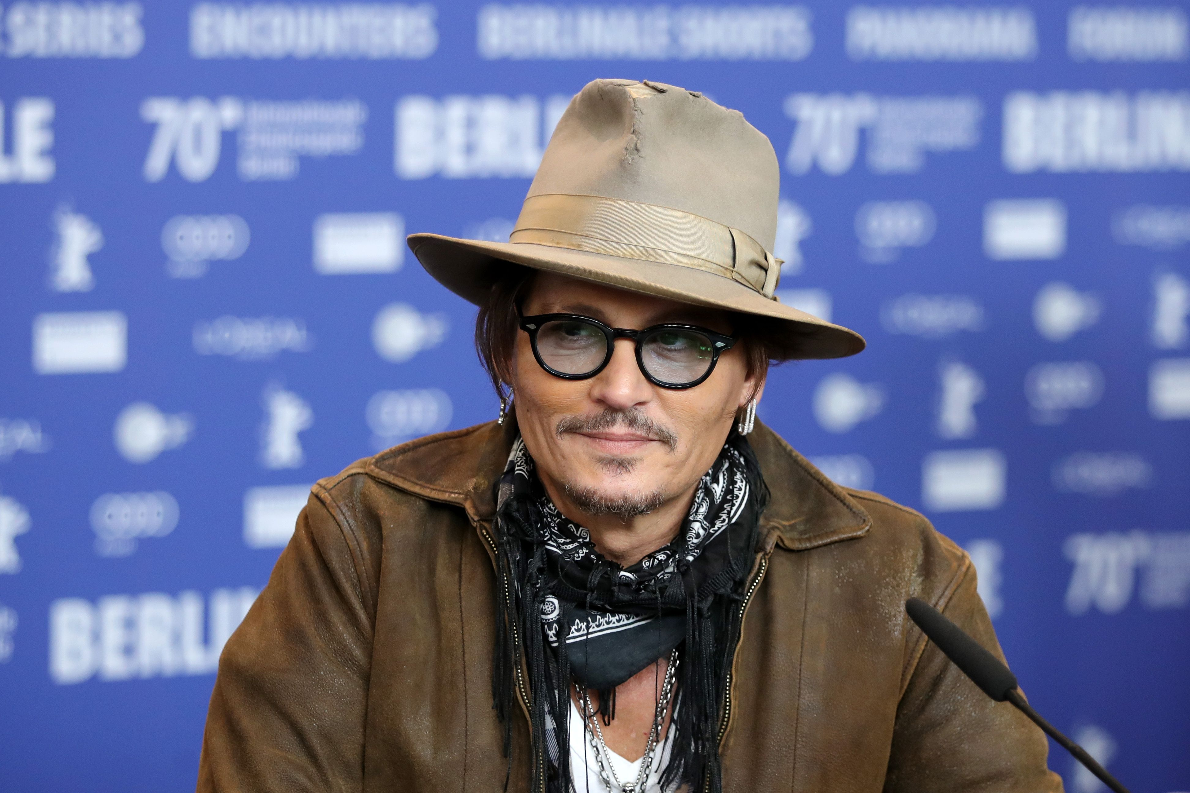 Johnny Depp and his ex-wife Amber Heard settled their divorce in