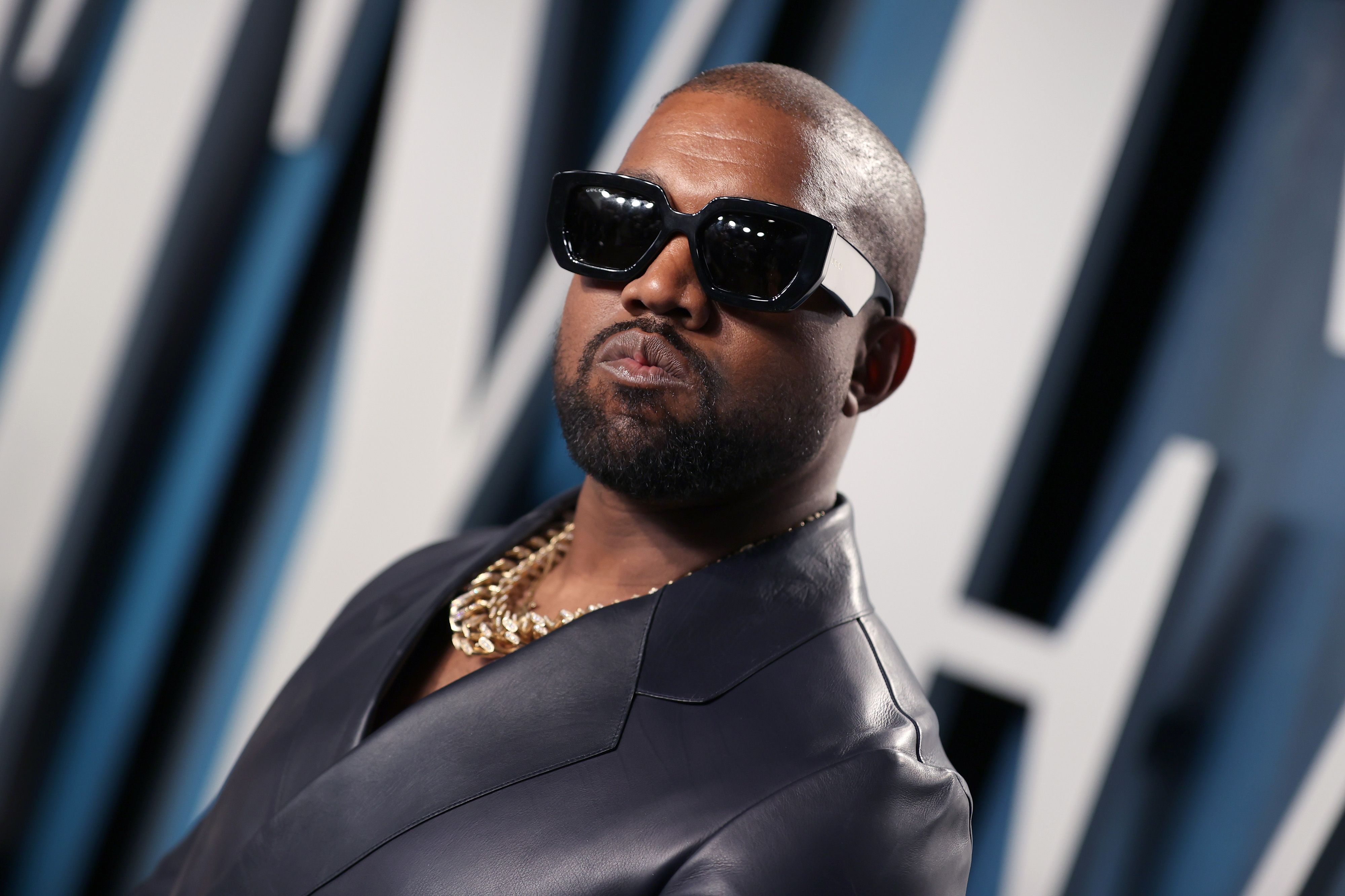 Kanye West poses for photographers