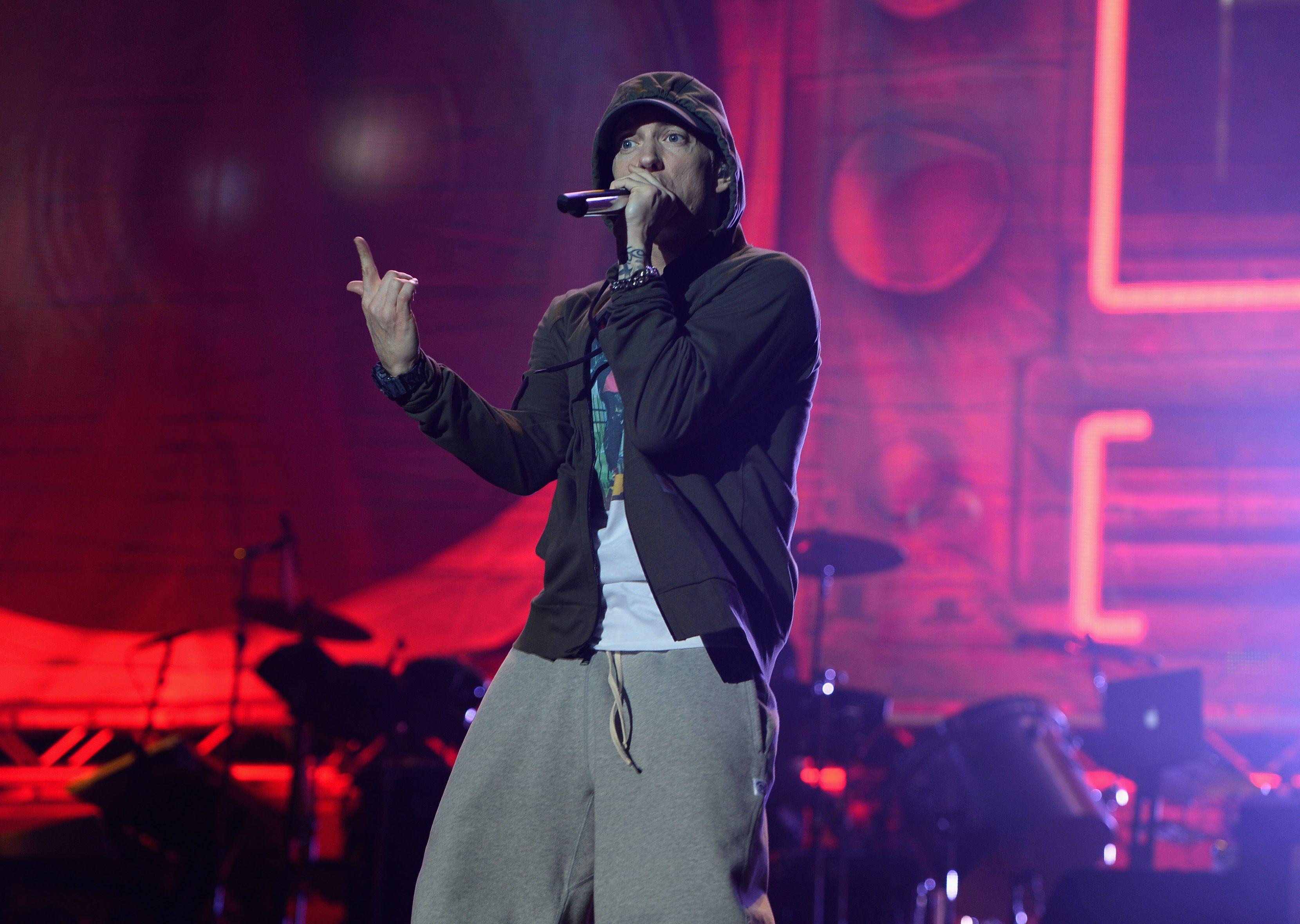 Eminem performing a rap on stage.