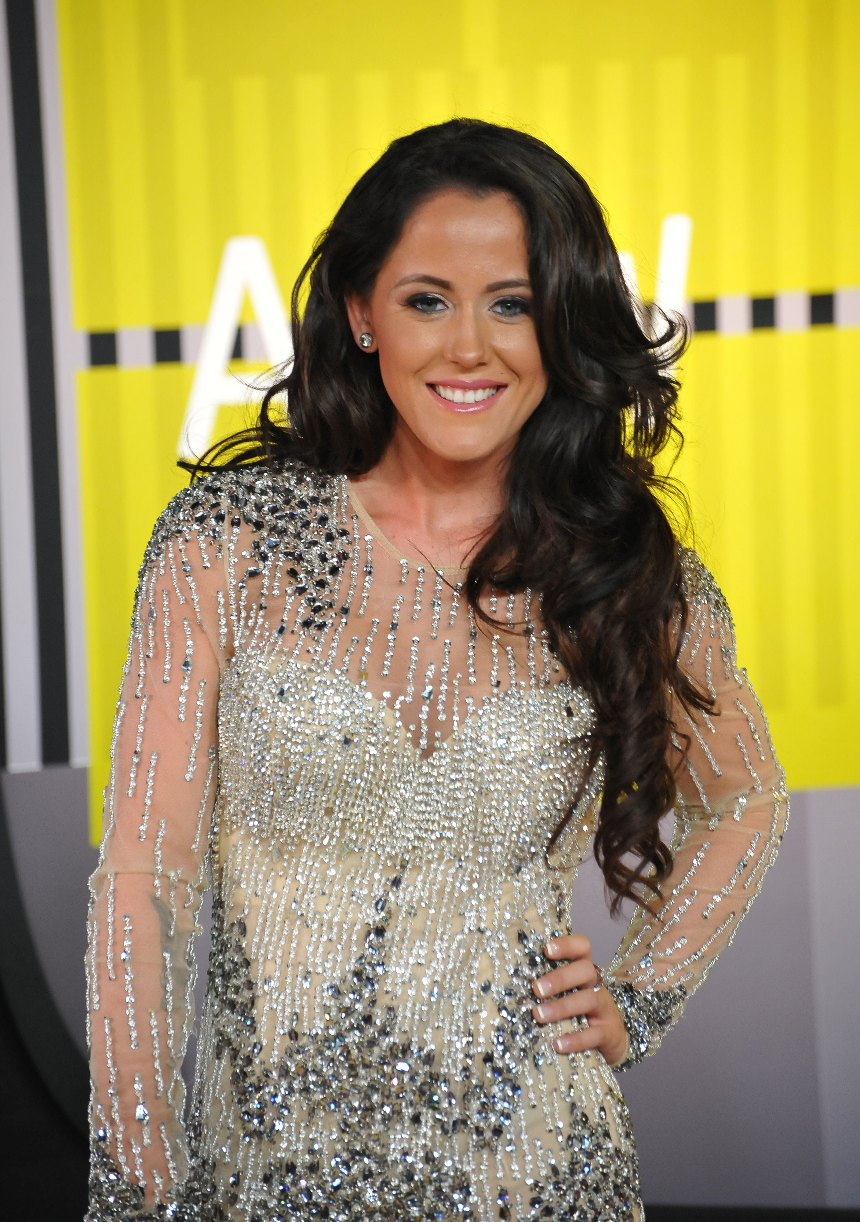 Jenelle Evans wears a beaded dress with sheer sleeves.