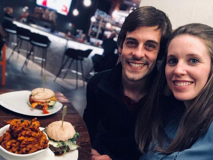 Jill and Derick Dillard at a restaurant