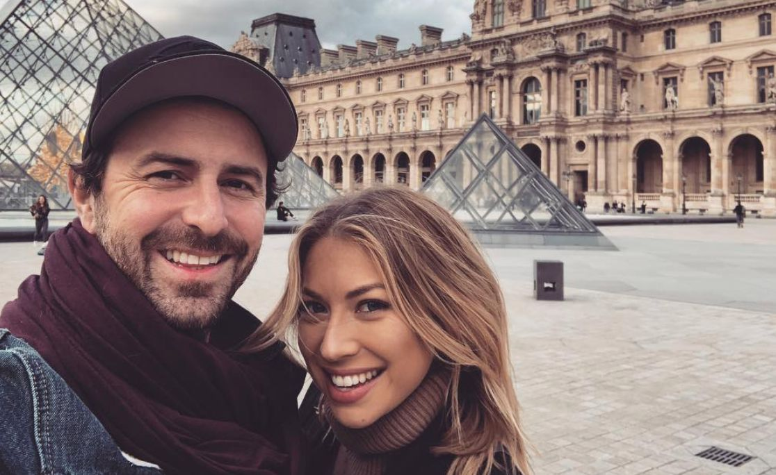 Beau Clark and Stassi Schroeder smiling while taking a selfie.