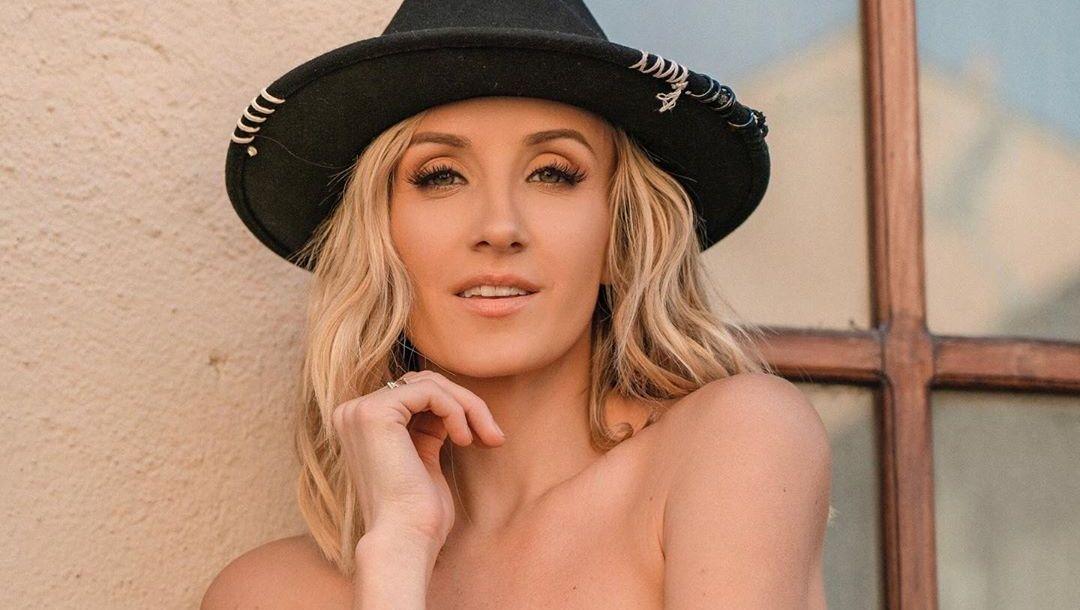 Nastia Liukin poses wearing a black hat
