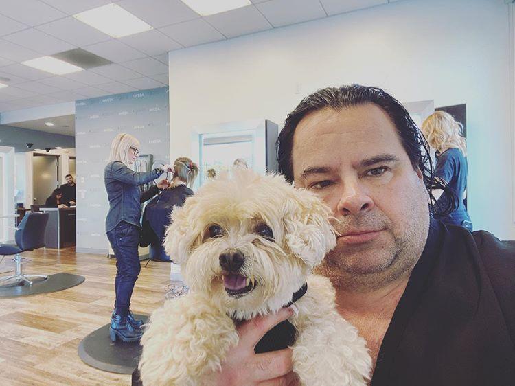 Big Ed holding small dog
