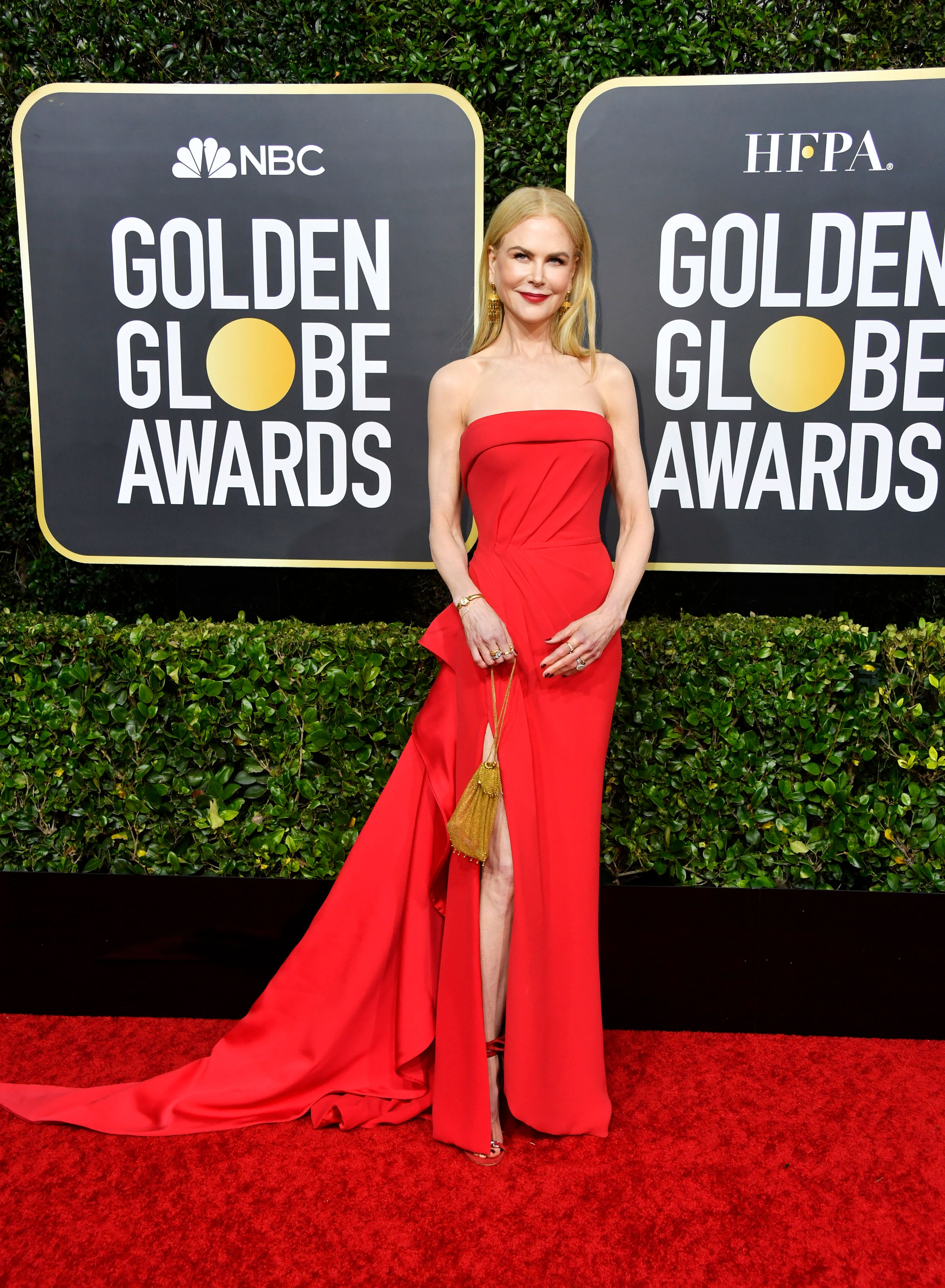 Nicole Kidman looks dazzling in red floor-sweeping dress with matching heel sandals on the red carpet.