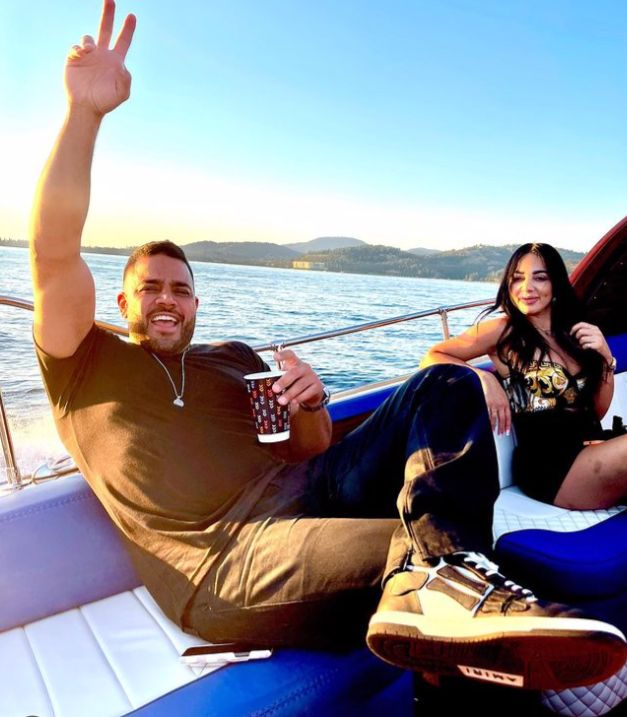 Mike Shouhed and Paulina-Ben Cohen on a boat.