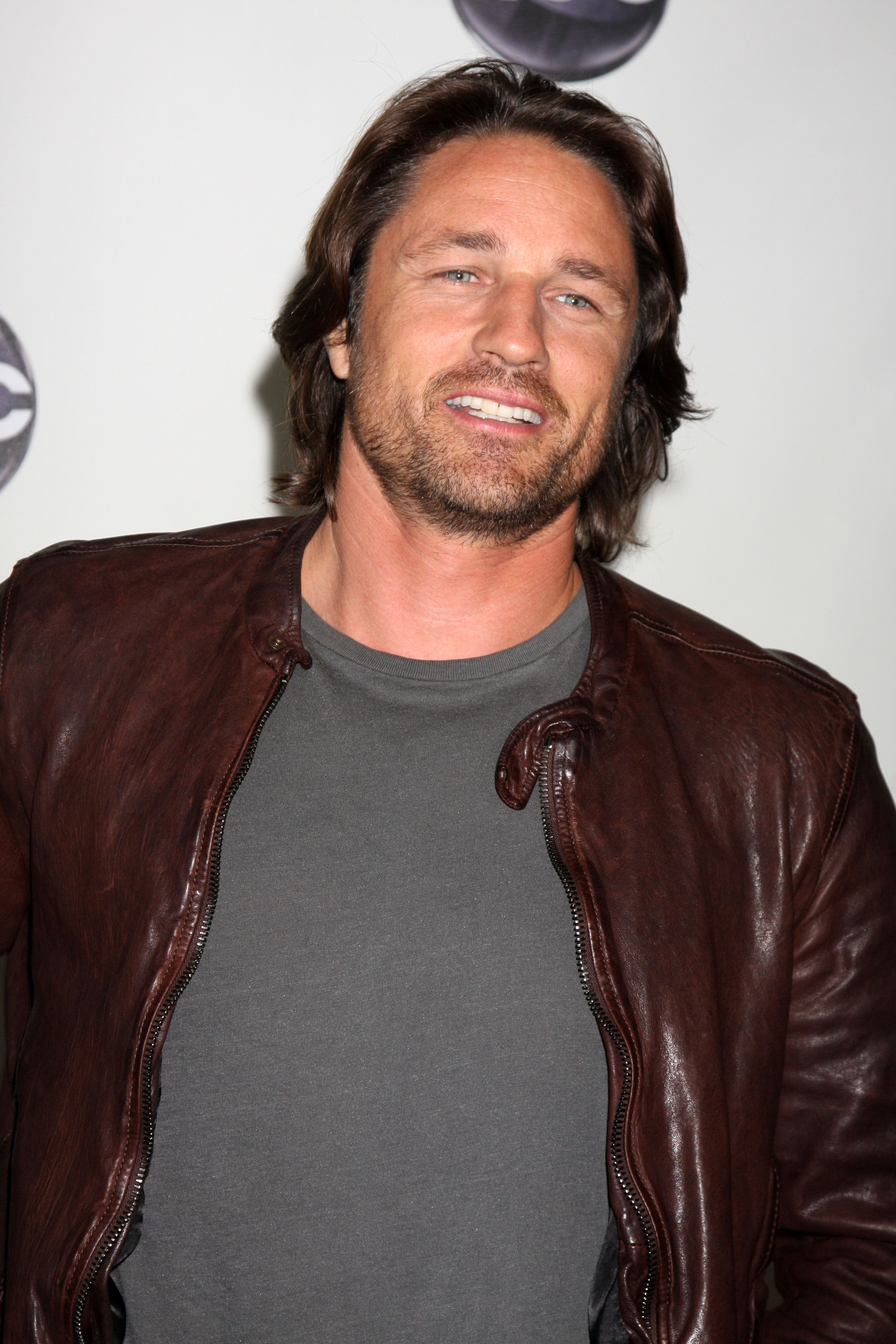 Martin Henderson in brown leather jacket.