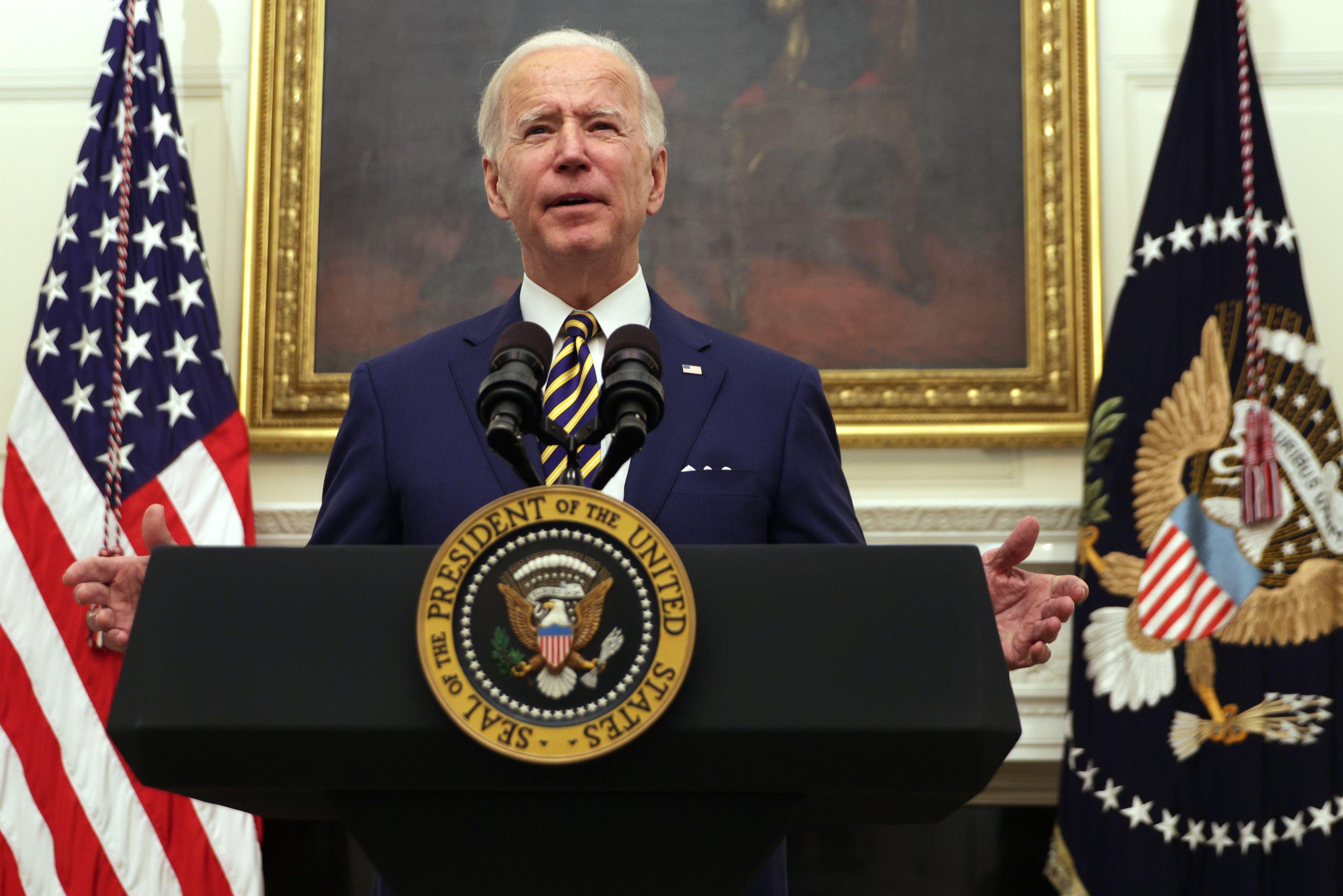 Joe Biden speaks from a presidential podium.
