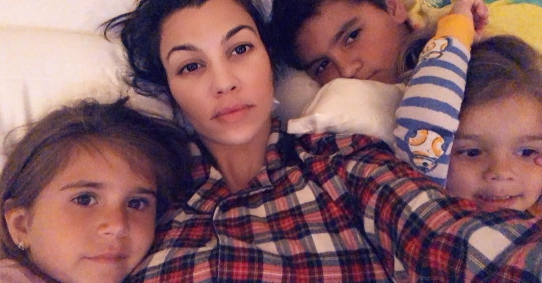 Kourtney Kardashian takes a snuggly bedtime selfie with her three children; May 2018.