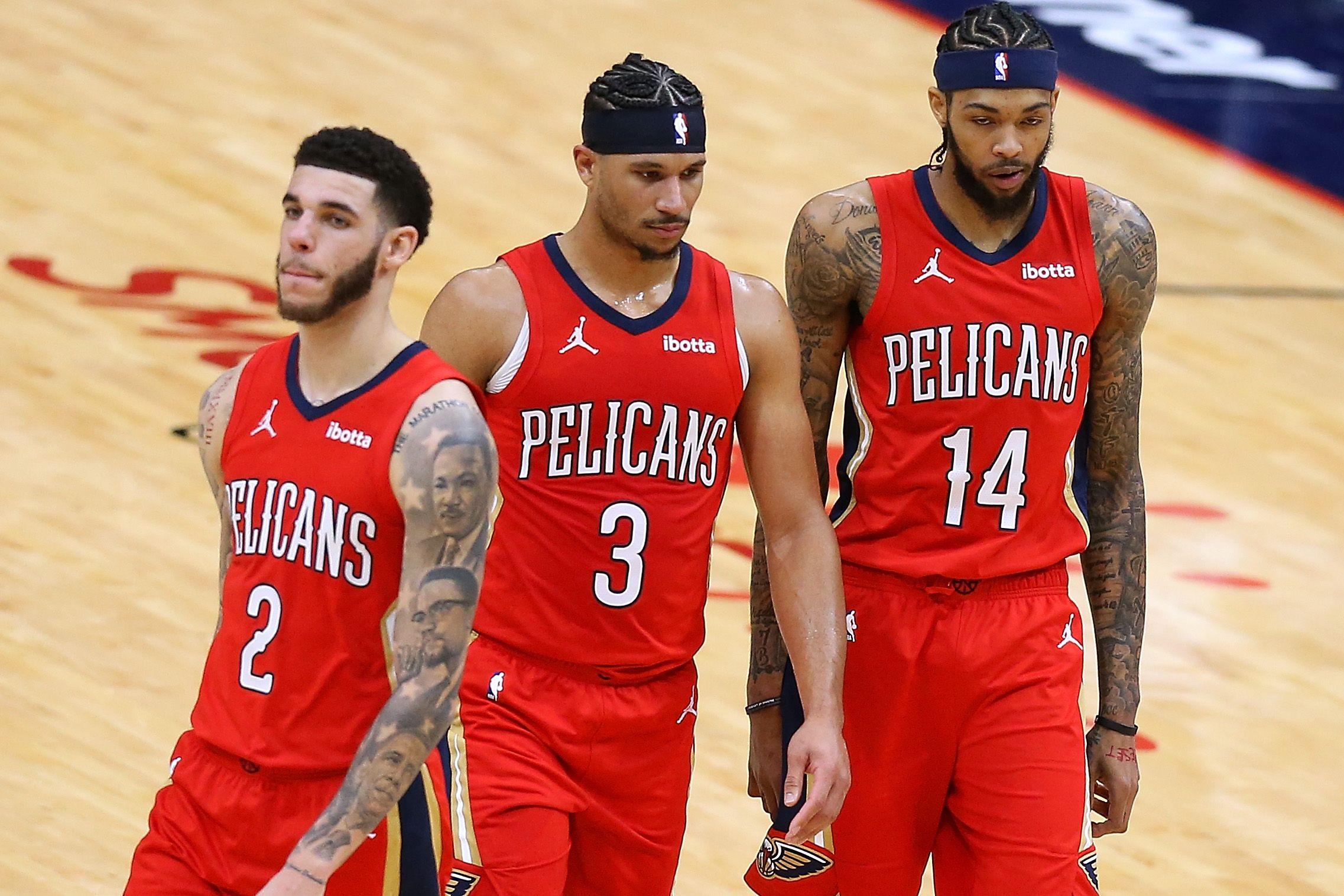 Former Lakers Lonzo Ball, Josh Hart, and Brandon Ingram walking together inside the court