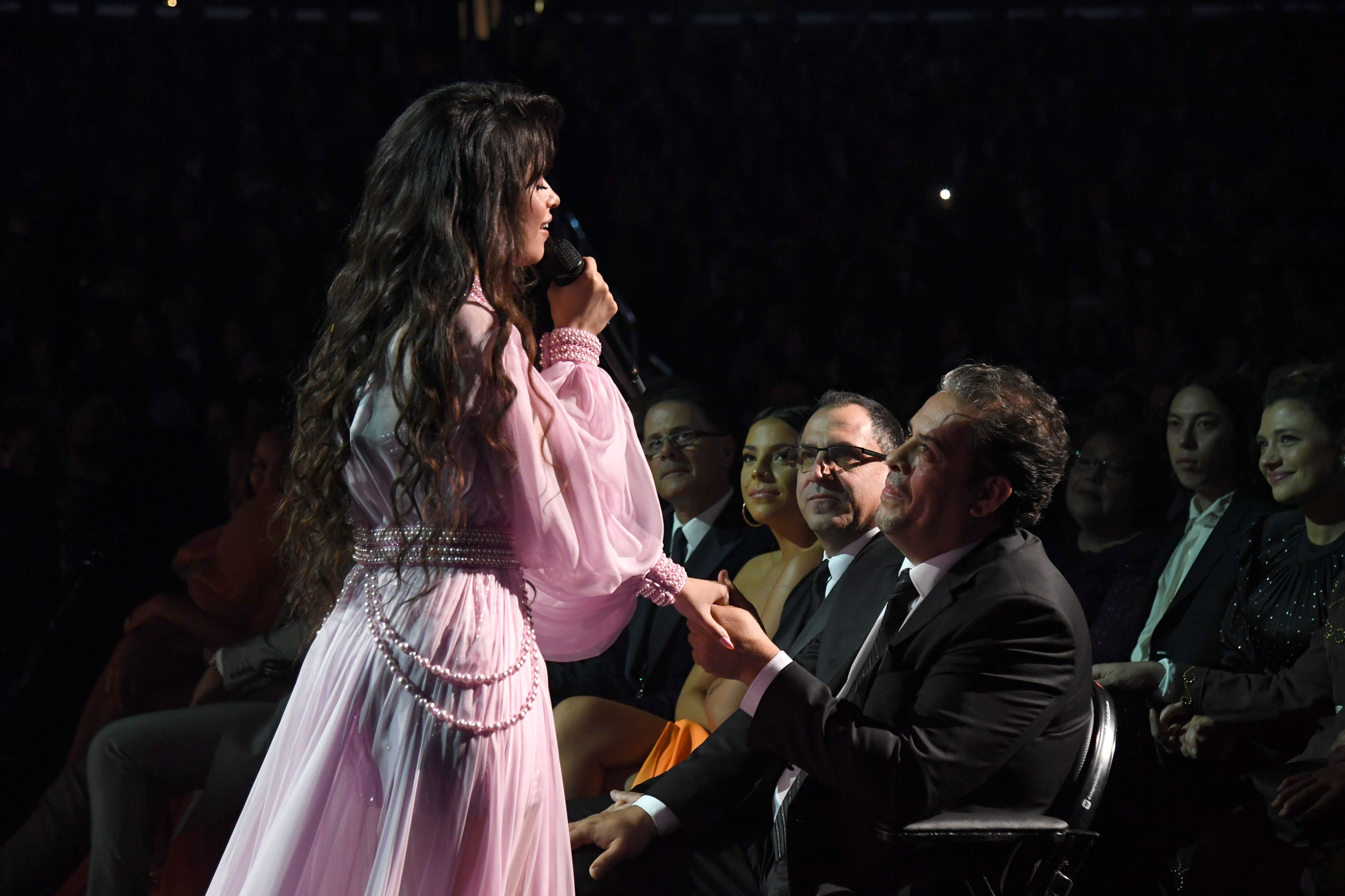 Camila Cabello singing to her father.