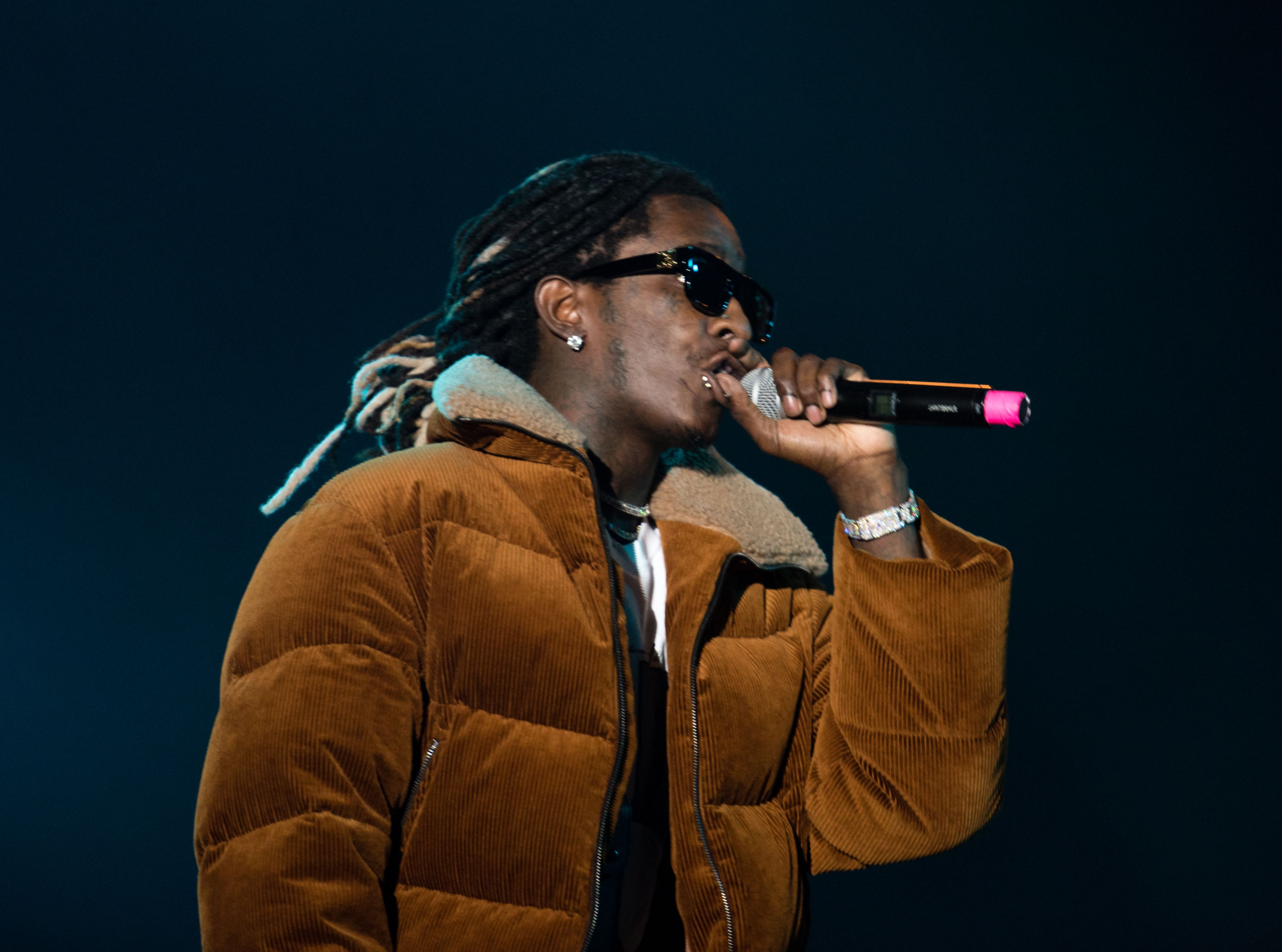 Young Thug performing on stage.