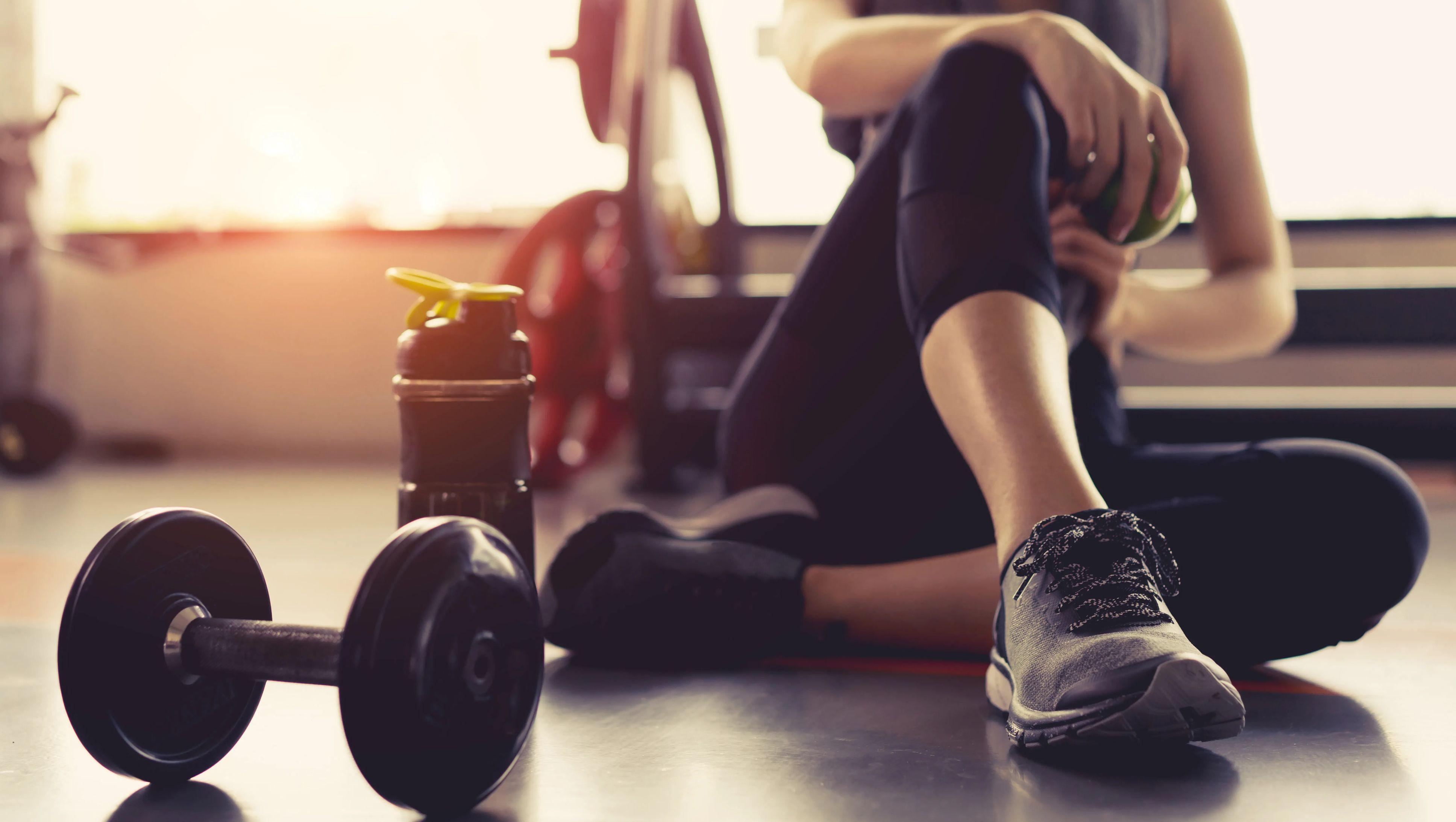 Girl in fitness wear on the floor.