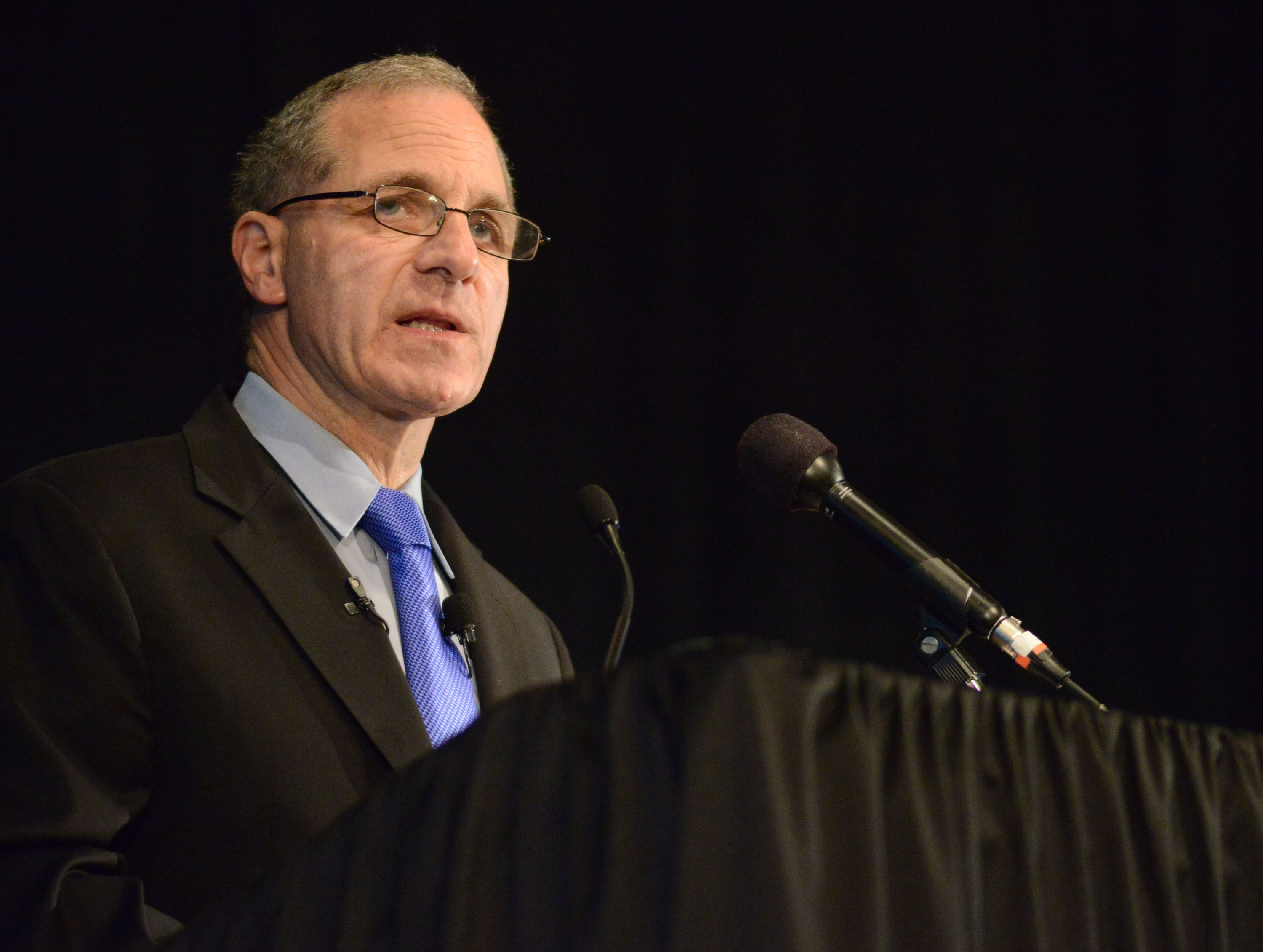 Louis Freeh speaks at an event.