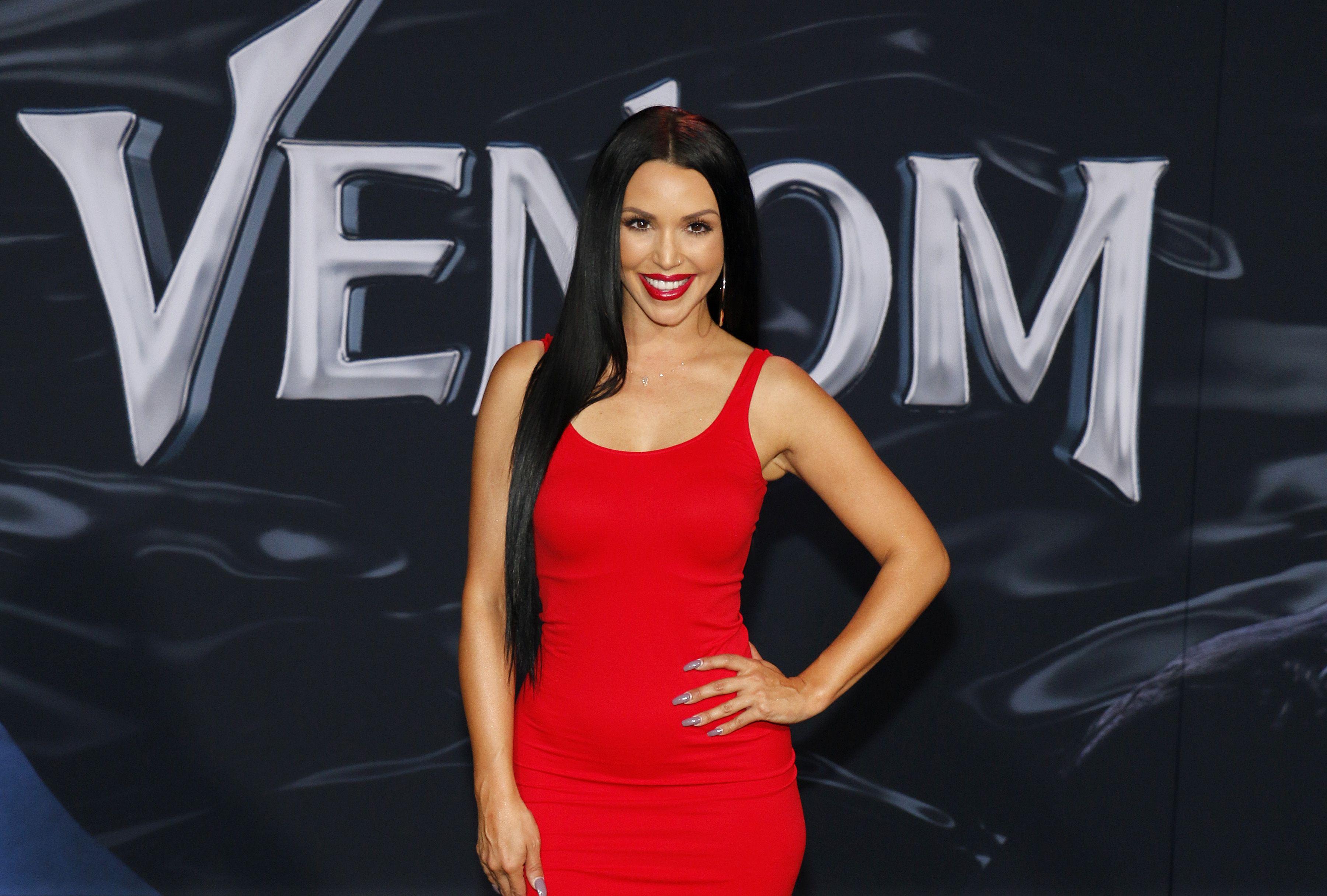 Scheana Shay wears a red dress.