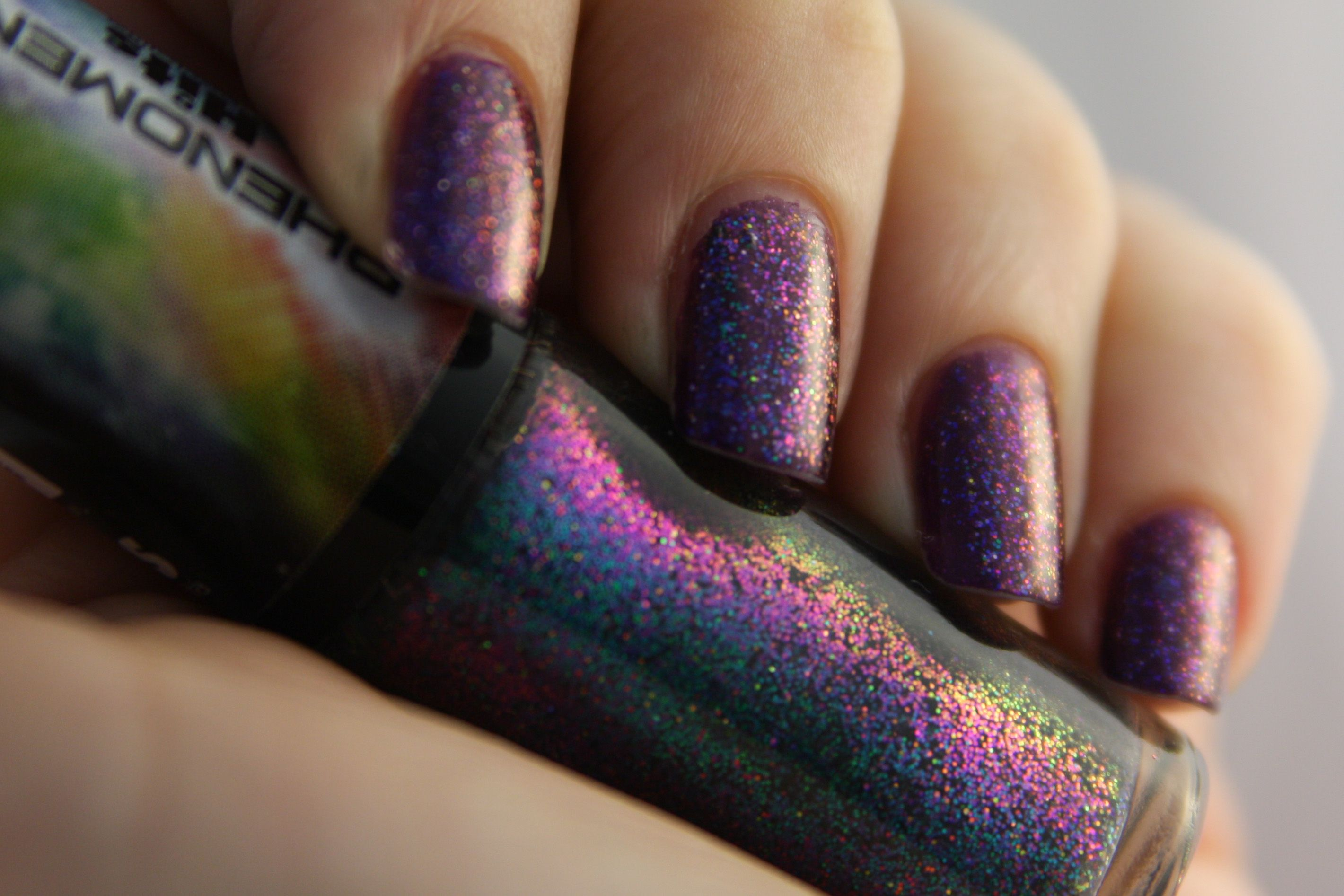 Purple glittery manicure.
