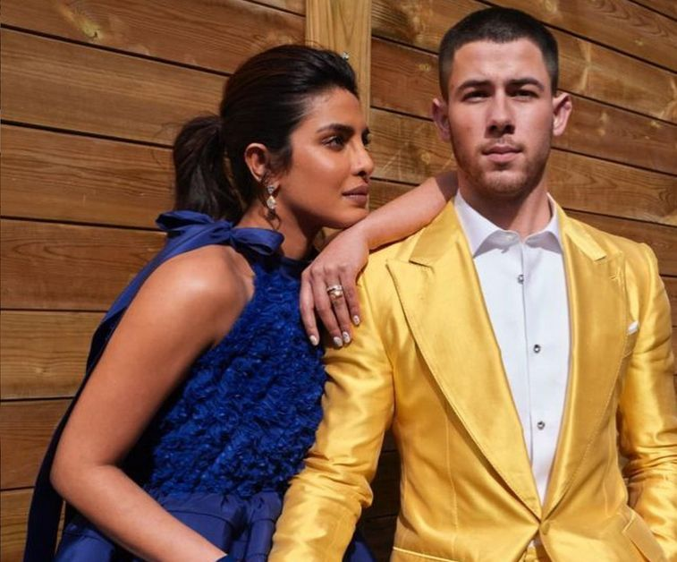 Nick Jonas with gold suit on