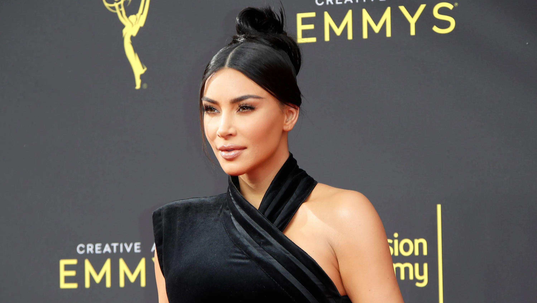 Kim Kardashian in a black velvet dress