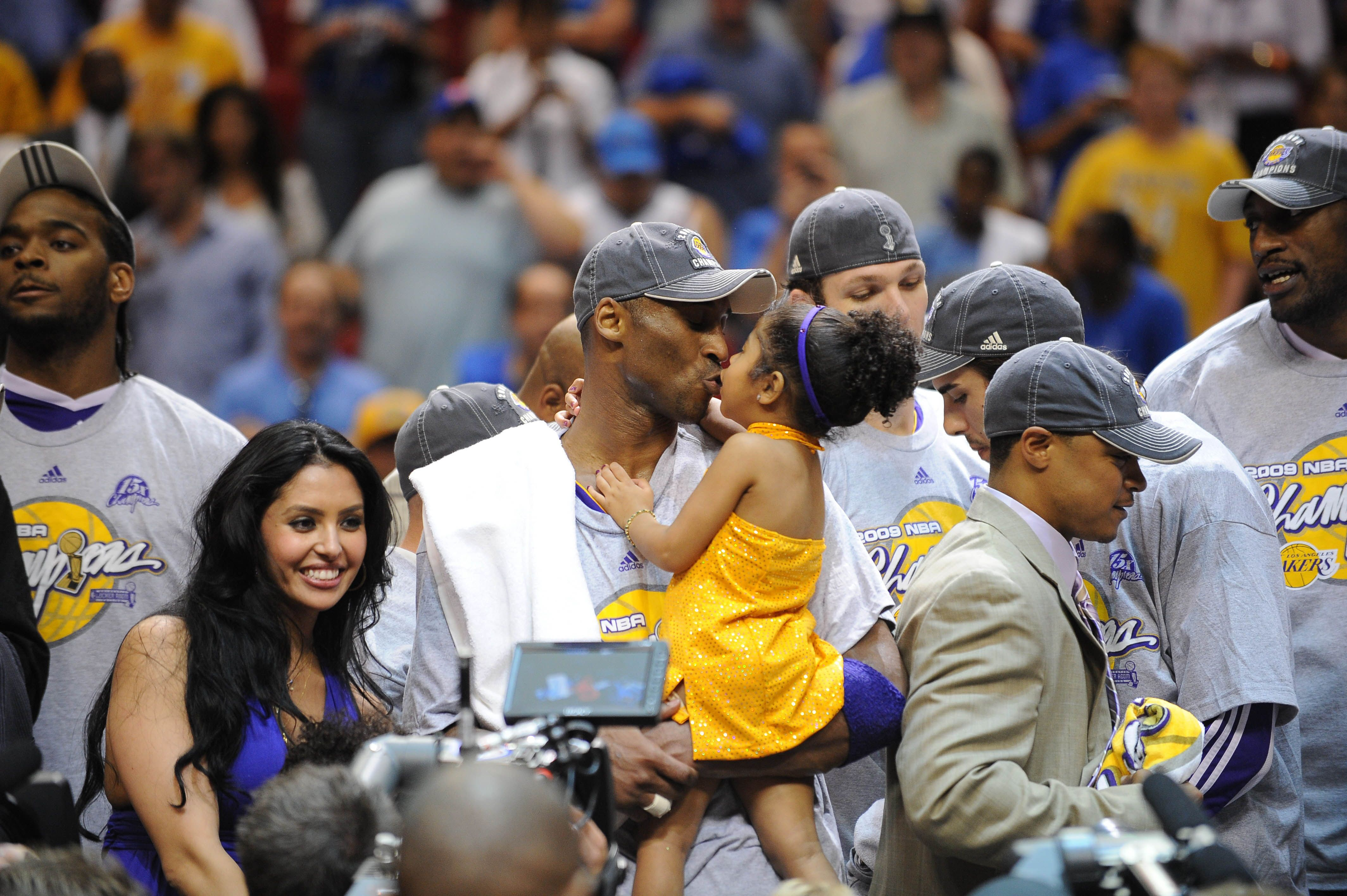 Kobe and his daughter at a basketball game