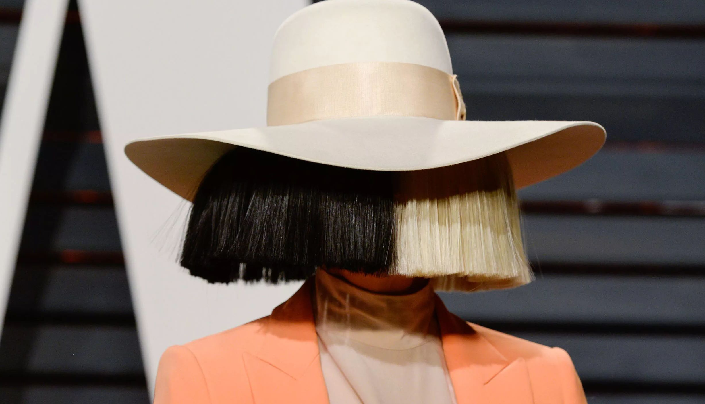 Sia with big wig on